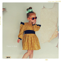 Girls Dress: Open Prairie Dress in Golden Print with Black Detailing from the Fleur and Dot Autumn Winter Collection