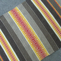 Striped handwoven rug in 3 natural brown wool colors with white and yellow, orange and red motifs - unique handmade rug