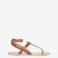 Ancient Greek Sandals Wrap Around Ankle Strap Flat Sandals at INTERMIX | Shop Now | Shop IntermixOnline.com