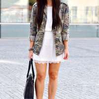 white dress and army jacket