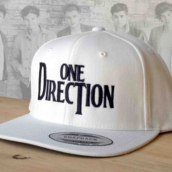 One Direction Snap Back with Custom Embroidered Logo.  Made to order quality snap back hats and designs.  Love 1D hats.