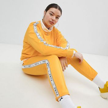 Puma Exclusive To ASOS Plus Taped Side Stripe Track Pants In Yellow at asos.com