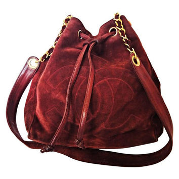 Vintage CHANEL wine red suede leather classic hobo bucket shoulder bag with drawstrings, CC stitch mark, and golden chain. Best daily purse