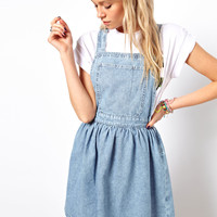 ASOS | ASOS Cross Back Denim Pinafore Dress in Light Vintage Wash at ASOS
