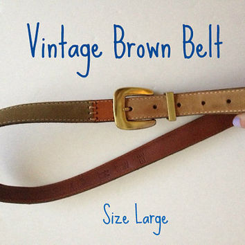 Vintage Fossil Belt.  Size Large.  Suede brown patches with leather and stitching.  Great addition to your wardrobe.