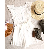 just the cutest ruffled eyelet romper - white