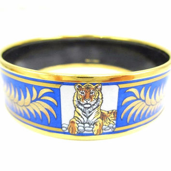 Vintage Hermes cloisonne enamel golden thick bangle, bracelet  with tiger and crown design in gold and blue.