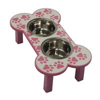 Pink bone shaped dog feeder with paw print. Elevated dog feeder