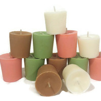 One dozen Christmas color and Christmas scented votive candles