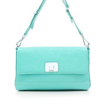 Tiffany & Co. -  Nanette shoulder bag in Tiffany Blue® grain leather. More colors available.