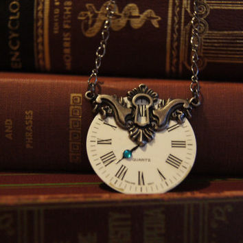 Unlock time necklace has a vintage clock face with by caitlinjohns