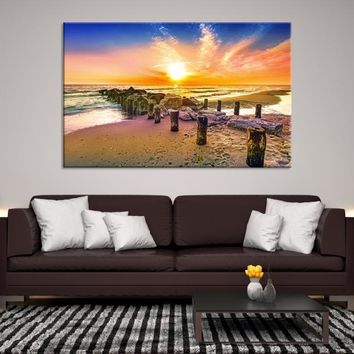 96944 - Old Piles on Beach with Blazing Sun Wall Art Canvas Print