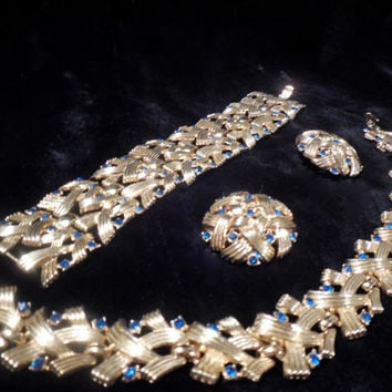 Crown Trifari Set, Necklace, Bracelet and Earrings in woven gold toned metal with deep blue rhinestones.  Art Deco style.