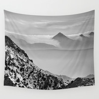 Hidden mountains Wall Tapestry by Guido Montañés