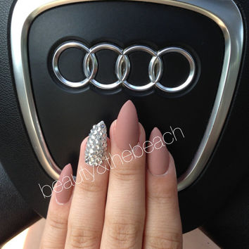 Matte nude with rhinestones on the ring finger nail set stiletto nails