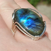 flashy labradorite ring in argentinum wire made to fit! gorgeous blues!