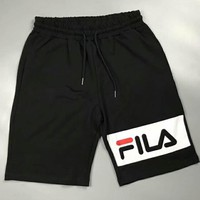 FILA New fashion side letter print couple shorts Black