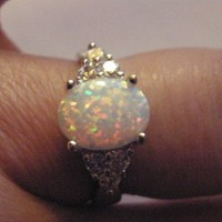 Pretty Sterling Silver and Fire Opal ring bound with spells of BEAUTY