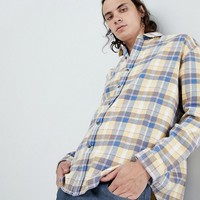 ASOS DESIGN oversized check shirt in yellow with bleach wash at asos.com