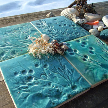 4 Ceramic coasters, shells, seaweed and fossils from Lyme Regis on the Jurassic coast, green and turquoise crackle glaze