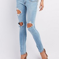 MACHINE JEANS LIGHT WASH DESTROYED SKINNY JEANS
