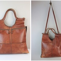 Vintage Brown Distressed Leather Fold Over Shoulder Bag or purse with a long cross body strap and 2 carrying handles