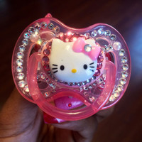 Pink pacifier with Hello Kitty, swarovski crystals, rhinestones, and pearls