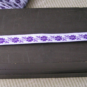 Jacquard Lilac Ribbon with purple flowers and vines. A 3/8 inch wide trim perfect for a young girl's Easter Dress.