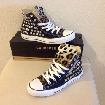 DCCKHD9 Custom studded black Converse Chuck Taylors with faux leopard fur size 8 women
