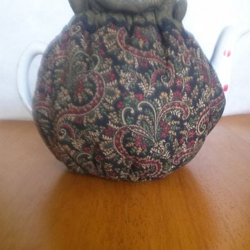 Quilted Teapot cozy with a Paisley of Green,Red, Cream on base black fabric for a 5-8 cup teapot