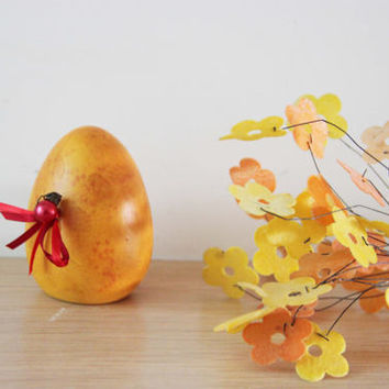 Yellow Easter egg, with ribbons and pearl, ceramic, earthenware egg in acrylic paint and varnish, Greek Easter egg, self standing, life size