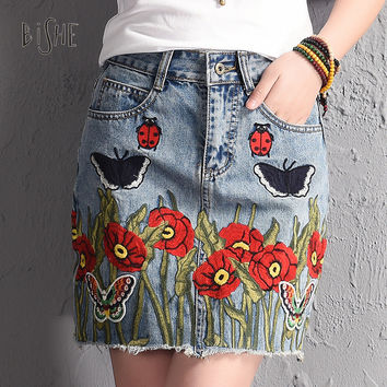 BiSHE Summer Style Women Mini Skirts Sexy Womens Pockets Light Blue Single Floral Embroidery Butterfly Denim Female A-Line Skirt
