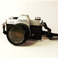 Vintage Canon TX 35mm SLR Manual Camera with 50mm Lens, Canon Camera Strap and Sunpak 55mm UV Filter with Lens Cap - Tested and Working