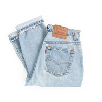 vintage levis jeans, high waisted levis ripped & faded jeans, distressed denim, tapered leg, made in usa - womens 29 x 26