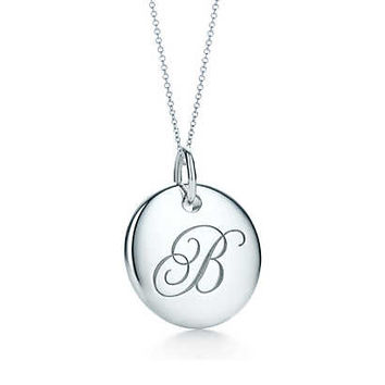 Tiffany & Co. - Tiffany Notes alphabet disc charm in silver on a chain. Letters A-Z available.