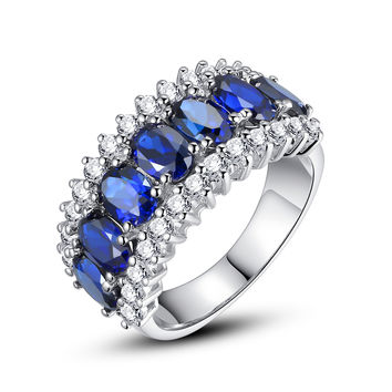 Sterling Silver 7-Stone Ring W. 7.5 Carats Oval Sapphire