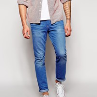 ASOS | ASOS Stretch Tapered Jeans In Light Wash at ASOS