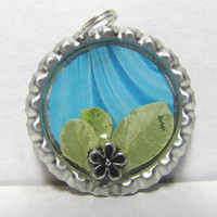 Dried Leaves & Silver Tone Flowers Over Teal Bottlecap Pendant