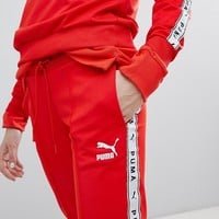 Puma Exclusive To ASOS Taped Side Stripe Track Pants In Red at asos.com