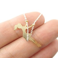 Girl Swinging on a Swing Acrobat Charm Necklace in Silver and Gold | DOTOLY