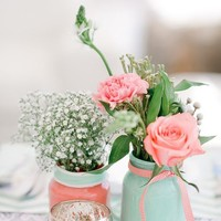 Painted mason jars in mint and pink with pink roses and babys breath make cute centerpieces | via Tumblr | We Heart It
