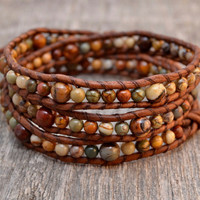 Graduated rustic beaded bracelet. Bohemian triple wrap leather bracelet
