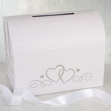 Use our White Wedding Card Holder Box to collect the warm thoughts on your wedding day! White Wedding Card Holder Box features silver glitter heart details. | Party City