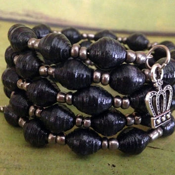 Handmade black bracelet, Memory wire bracelet, Silver sword and crown charms, Comfortable and lightweight