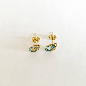 14K Yellow Gold Post Earrings with Pear Shaped Faceted Blue Topaz and Gold Leaf Accent