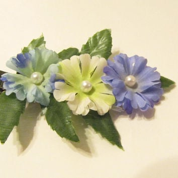 Spring flowers in soft blues on a duckbill ribbon by Starfall