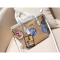 Coach sells fashion cartoon print shoulder bag casual lady shopping bag