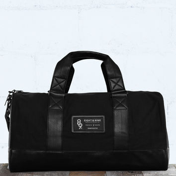 Triple Black Canvas Duffel Bag