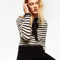 FRAYED CROPPED SWEATER DETAILS