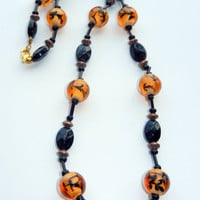 Orange and Black Beaded Necklace with Gold Beads